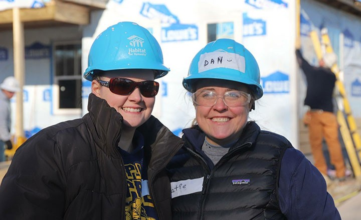 Kraft's team doesn't mind getting their hands dirty for a great cause like Habitat for Humanity.